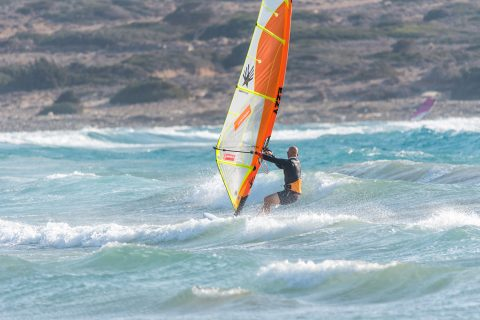 In onshore winds heading downwind prior to take off will get the sail lighter, give you more options and get your board speed up ready to boost more height. Photo by Eye Sea You.