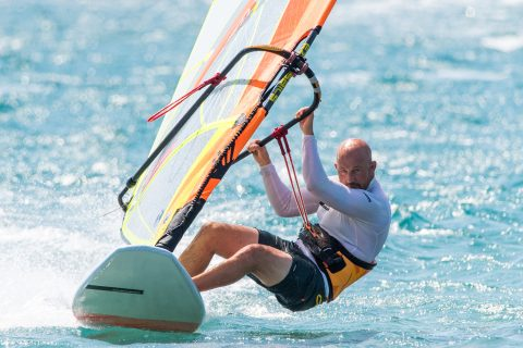 Really dropping your hips down and out will help you sheet the sail in and keep the board flat when well powered.